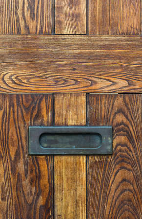 letter box: Letter box on old vintage wooden door background Stock Photo