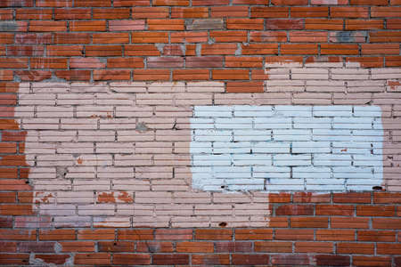 detrimental: Painted over Graffiti covering on brick wall background Stock Photo