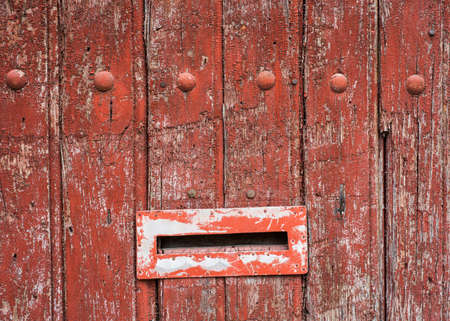 scraped: old decaying grunge background letterbox on door Stock Photo