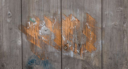 graffiti scrapped off painted wooden door