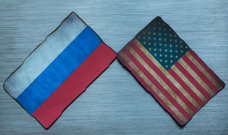 adversaries: grungy American and Russian flag background