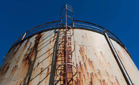 Old Abandoned And Rusty Oil And Gas Storage Containers Stock Photo