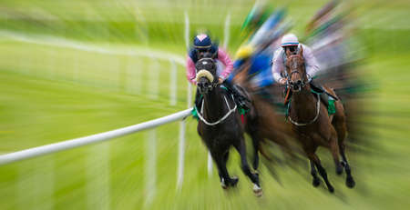 Race horses and jockeys competing, extreme motion blur zoom effect