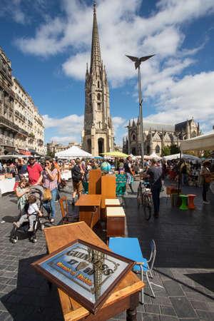 BORDEAUX, FRANCE- September 23rd, 2018: People shopping at Place de Saint Michael antique flea market on Sunday morning.