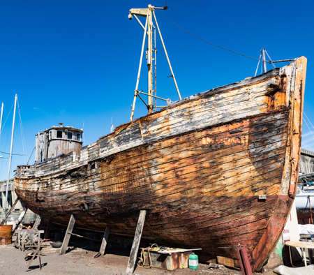 Old wooden fishing boat in a repair yard beside the World War 2 BETASOM submarine base in Bordeaux, France