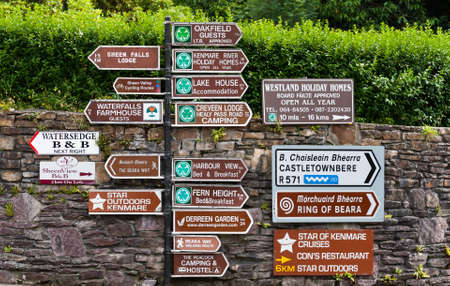 Kenmare, Ireland - 20th July 2017 directional road signs towards places of interest and accommodation in County Kerry, Ireland Editorial