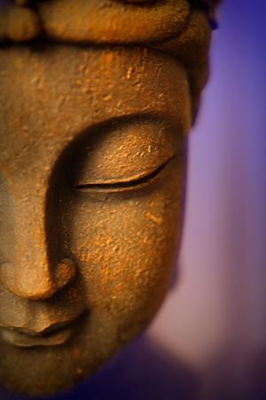 stone buddha: Purple Buddha Stock Photo