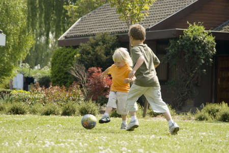 Two brothers playing football