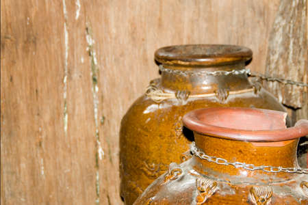 antique pots made of stone, one is broken Stock Photo