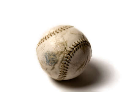 shortstop: An old baseball, isolated on white