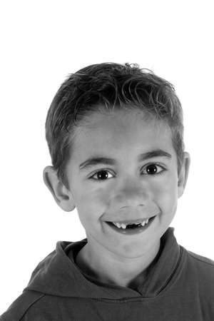 seven year old: a seven year old boy without two teeth