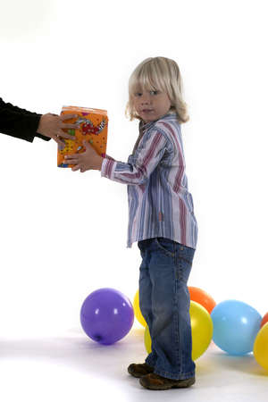 a three year old birthday boy is receiving a present Stock Photo - 1934919