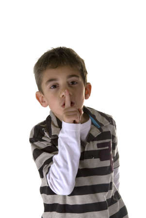 shh. secret - Young boy with his finger over his mouth