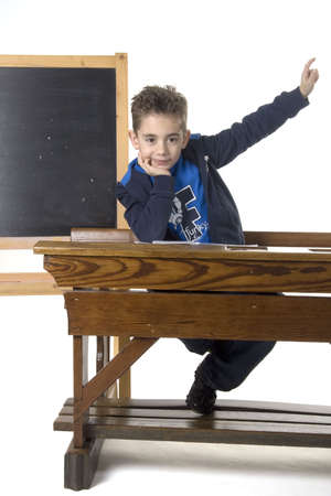 schooldesk: a boy want the ask the teacher something