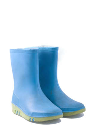 dirty blue rainboots, isolated on white Stock Photo