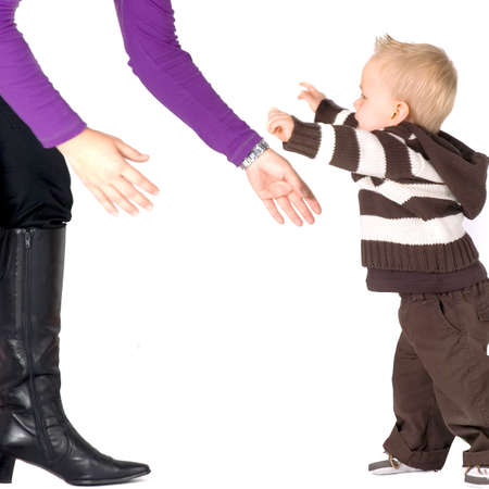 Babys first steps, walking trough his mom Stock Photo