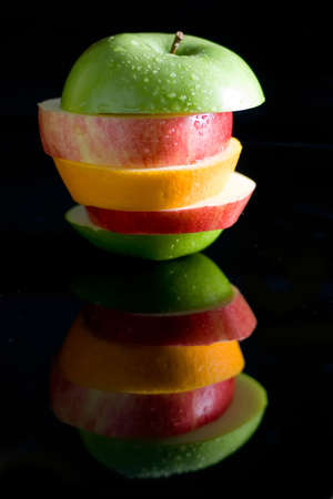 a pile of different fruit on black Stock Photo