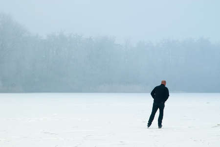 winterday: a lonely skater on a winterday