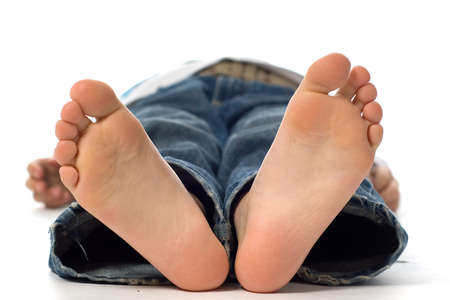 boy feet: an unconscious young boy Stock Photo