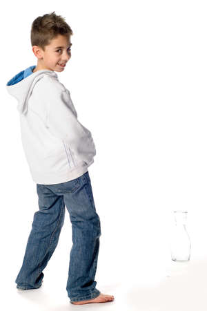 A boy pee in a bottle Stock Photo