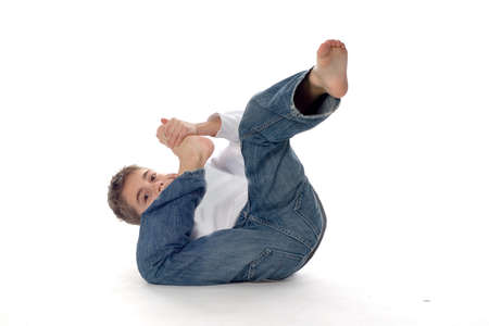 foot pain: a boy is rolling on the ground Stock Photo