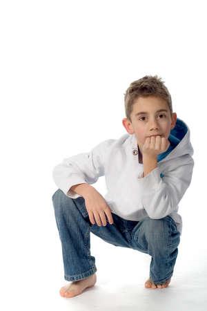 a tough boy, sitting, on a white background