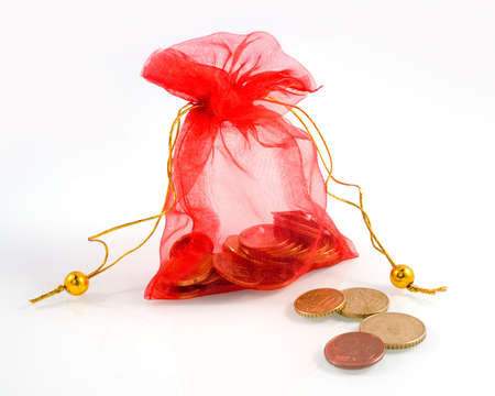 Bag of gold coins: a little red bag with money and a couple of coins in the front Kho ảnh