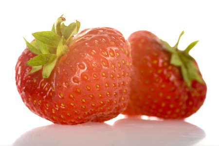 two strawberries, fresh and healthy, isolated on white Stock Photo - 5231911