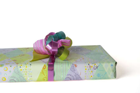 a part of a present, decorated with a colorful bow photo