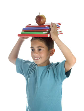 a boy with a pile of books and a healthy apple photo