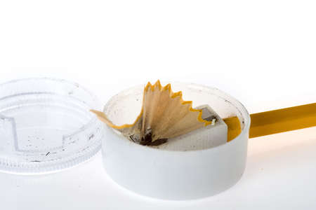sharpenings: a sharpener with a pencil and wood shavings
