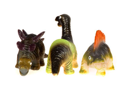 three little dinosaurs on a row, on white Stock Photo - 5378883