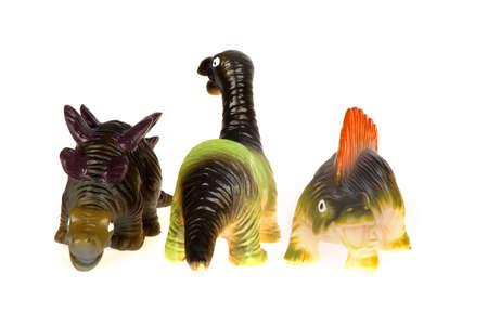 three little dinosaurs on a row, on white Stock Photo - 5378883