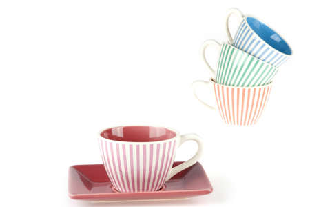 coffeecup: a striped coffeecup in the front and a pile in the back of the picture Stock Photo