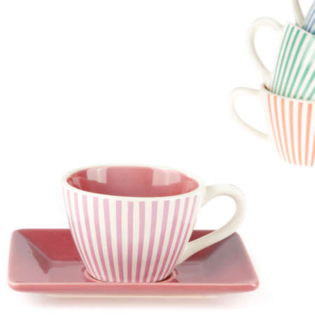 coffeecup: a colorful coffeecup in the front and a pile in the back