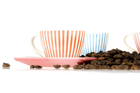coffeecup: a coffeecup with a lot of coffeebeans on white