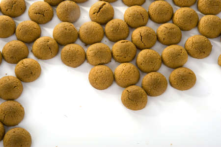 a border of gingernuts (pepernoten), In holland we will eat this to celebrate Sinterklaas, 5th december. Stock Photo