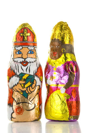 zwarte piet: two figures called sinterklaas and zwarte piet made of chocolade