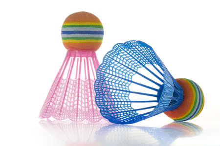 a blue and a pink shuttlecock Stock Photo