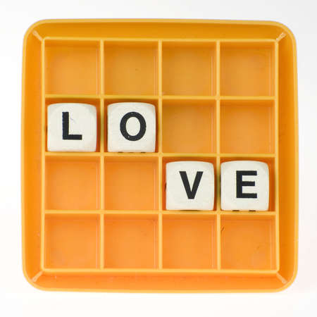mariage: a lot of old dices with letters spell out love