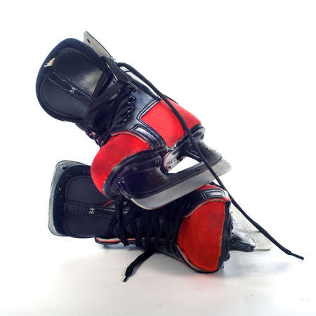 two red and blue ice-skates for a young child photo
