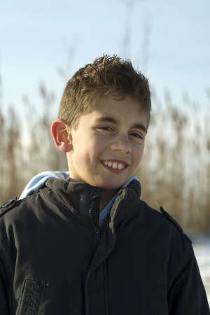 winterday: portrait of a young boy in the sun on a winterday Stock Photo