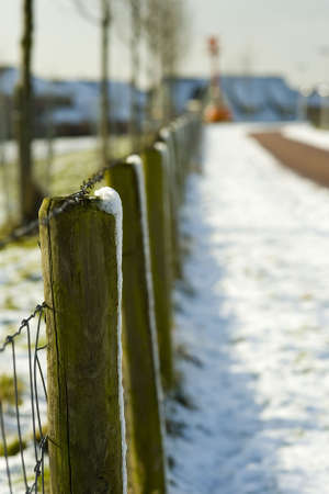 winterday: a fence in the snow on a sunny winterday Stock Photo