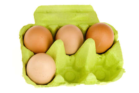 four eggs in a green box Stock Photo - 6578153