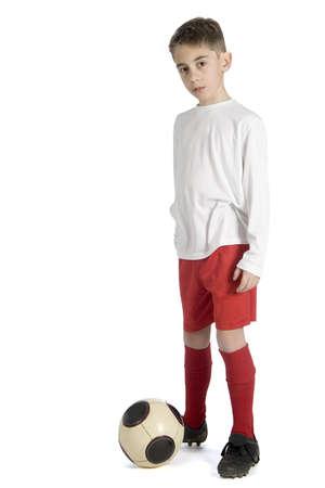 uniforme de futbol: un ni�o en el f�tbol uniforme listo para comenzar el juego Foto de archivo