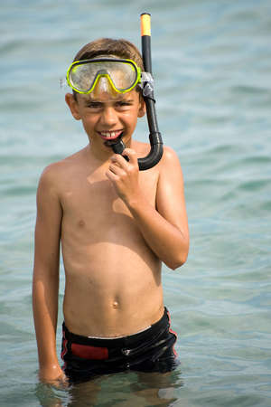 snorkelling: a young boy with a snorkel in the sea Stock Photo