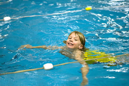 a boy is learning how to swim Stock Photo