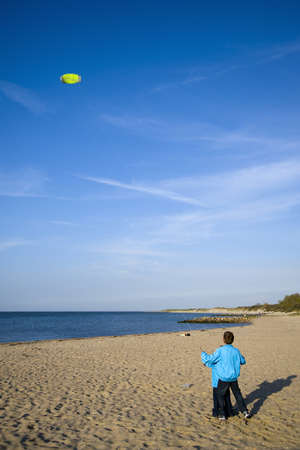 kiting: two boys are kiting with there yello kite Stock Photo
