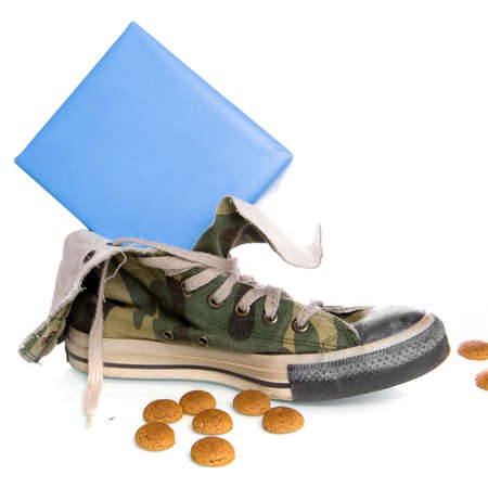 a shoe with cookies and a present, a dutch tradition Stock Photo - 7825135