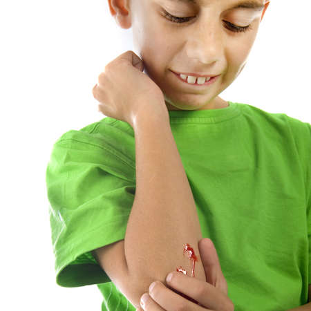 a young boy with a painful elbow on white photo